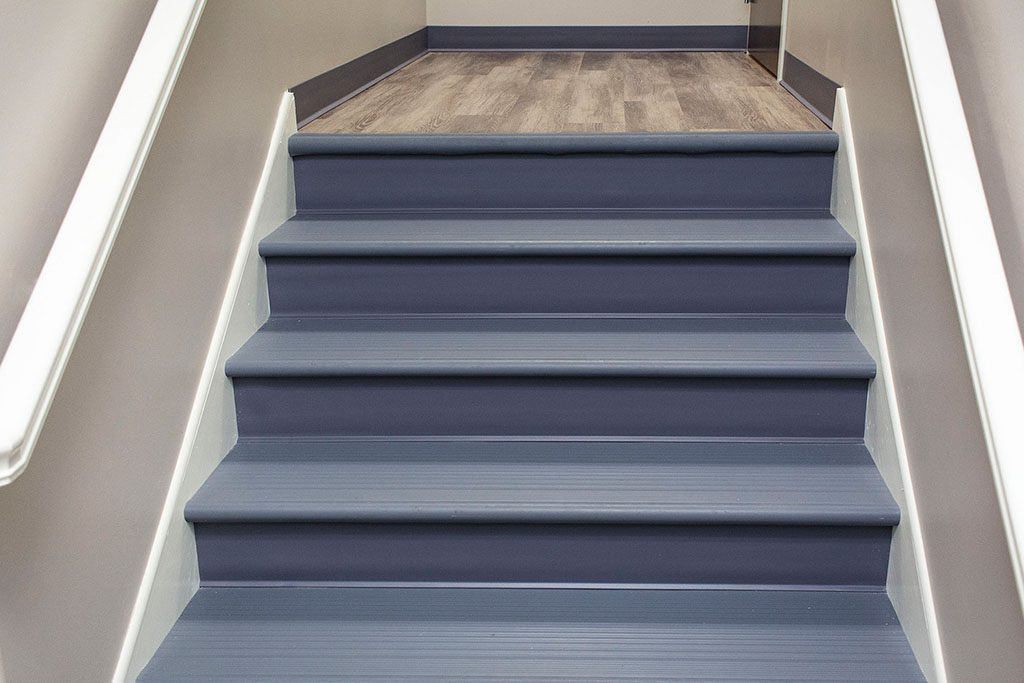 IMG_8644-web-landing-lvp-vinyl-plank-wood-stairs-vinyl-treads-risers-new-holland-transport-september-2018-dandsflooring.jpg