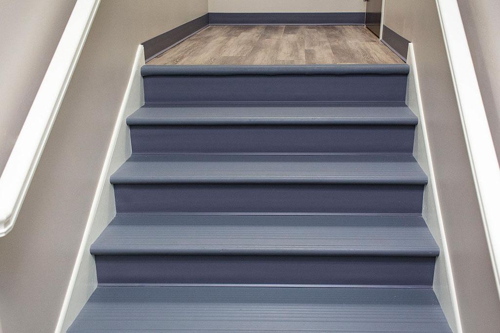 IMG_8644-web-landing-lvp-vinyl-plank-wood-stairs-vinyl-treads-risers-new-holland-transport-september-2018-dandsflooring.jpg