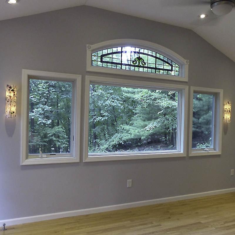 Custom sconces frame a large window.jpg