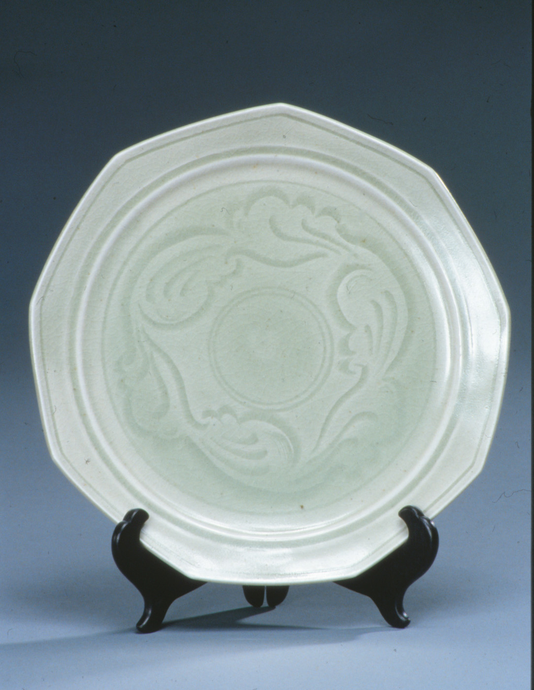 Carved porcelain plate with Northern celadon glaze