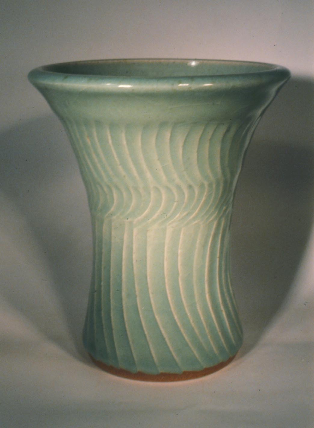 Carved stoneware with iron foot, northern celadon glaze