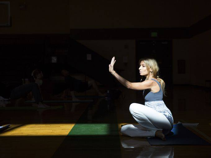"""Wendy Campbell, 41, leads a yoga class at the North Collier Regional Park gym on Friday, Dec. 16, 2016. Campbell, who was diagnosed withHodgkin's Lymphoma 10 years ago, is trying to bridge that gap between cancer treatment and mental well-being through her 501(c) 3 nonprofit organization called """"Survive &Thrive."""" Campbell teaches cancer survivor yoga and provides them with other wellness resources.    (Photo: Nicole Raucheisen/Naples Daily News)"""
