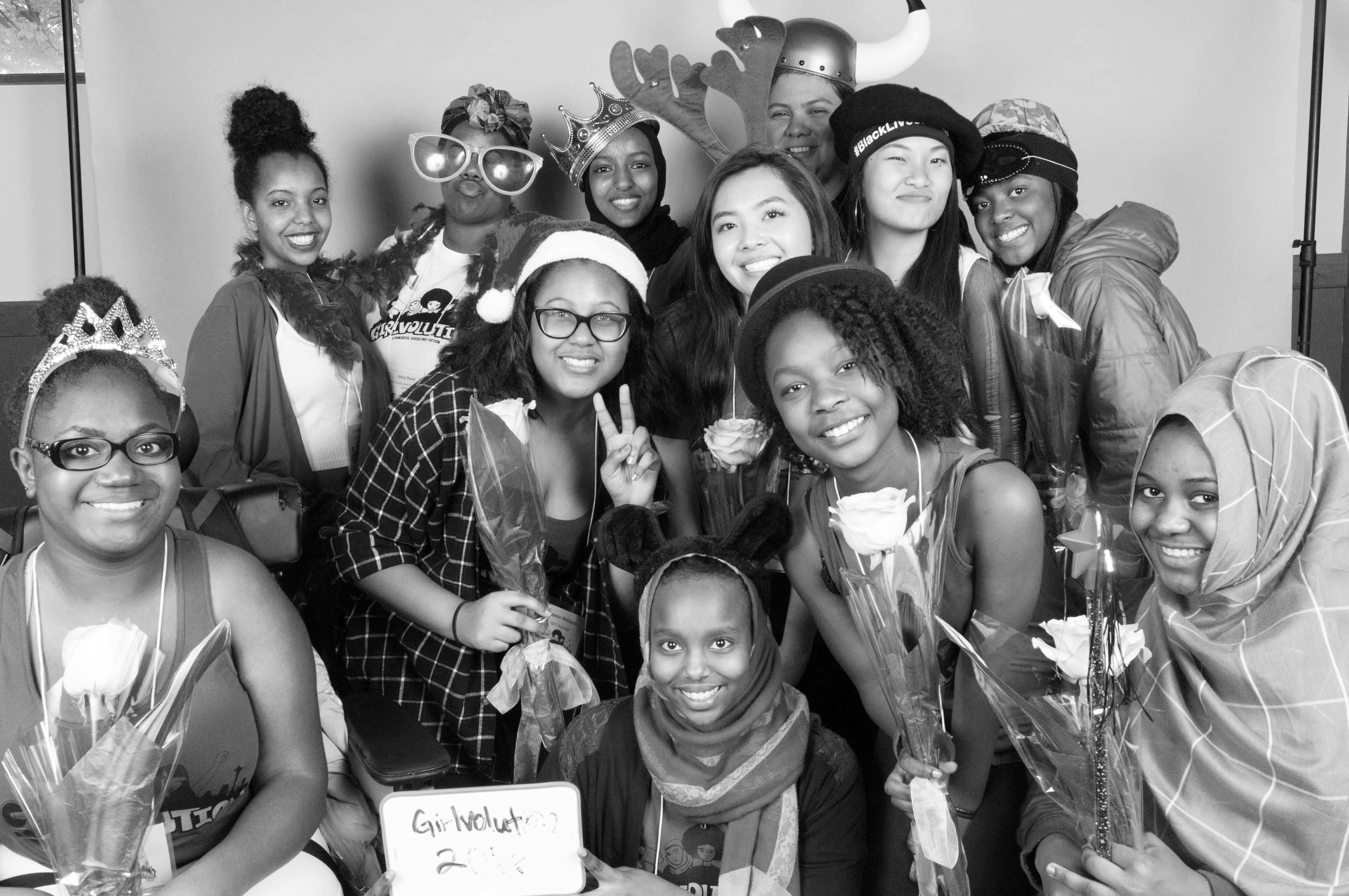 The 2017 Activistas and Powerful Voices staff posing in the Youth In Focus photobooth at our youth-led, social justice Girlvolution Conference