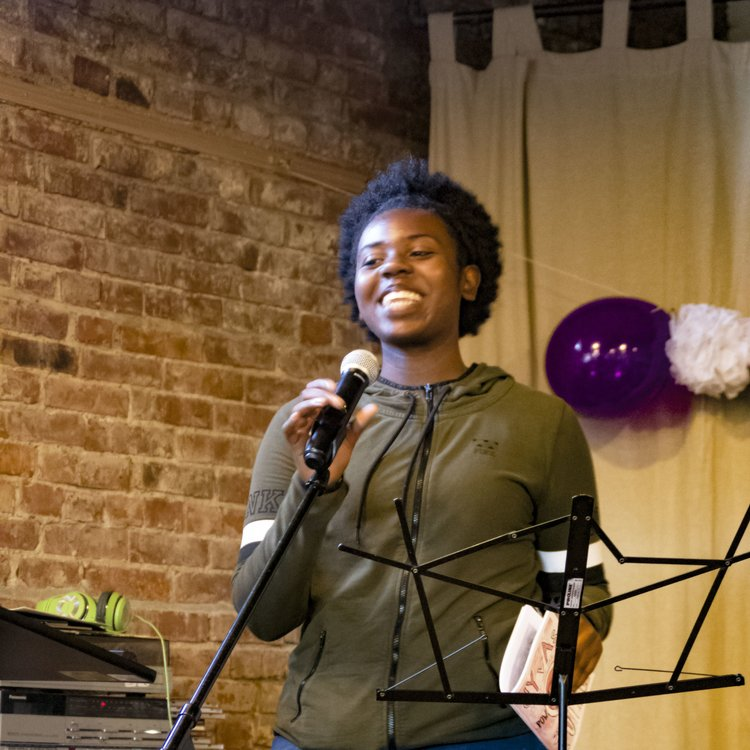 A 2016 DYVAS participant performing her poem at the DYVAS Celebration