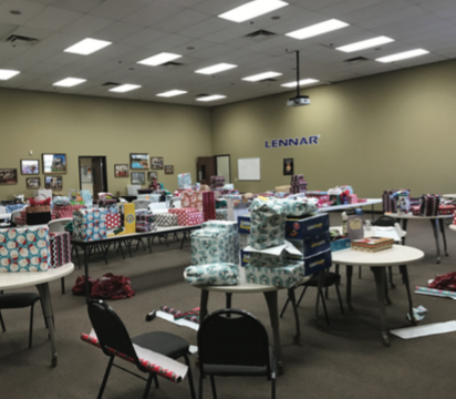 Presents from Lennar for Home Free residents ready for Christmas celebration.