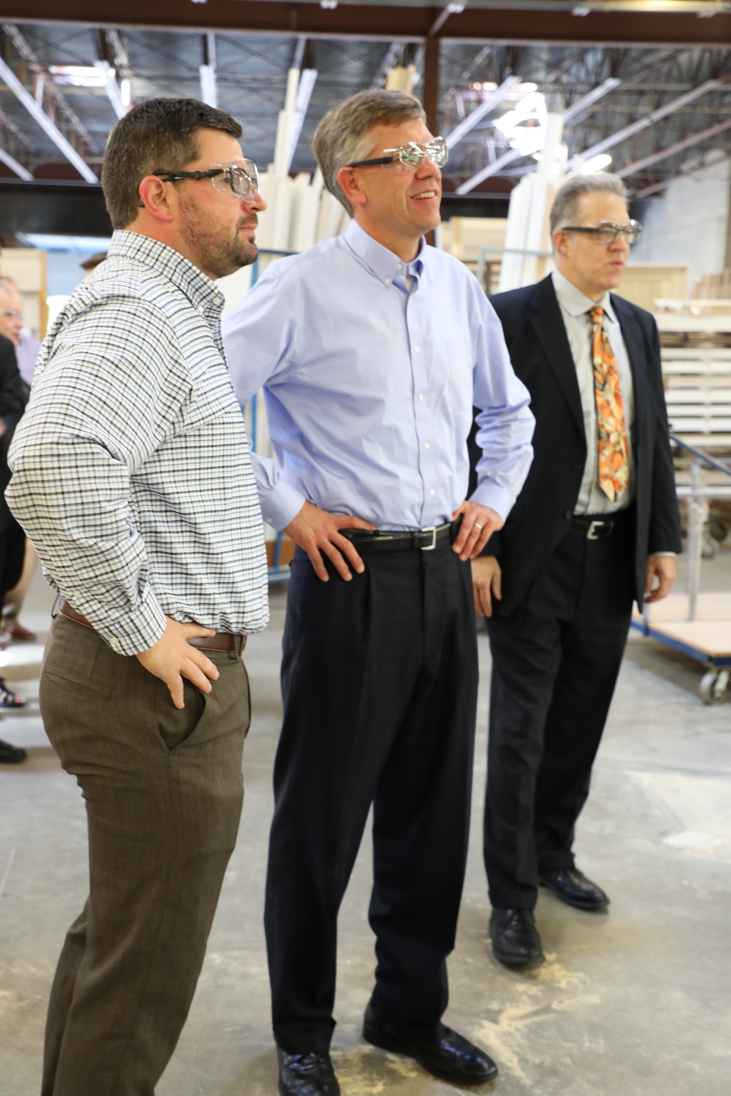 Housing First Minnesota board member, Charlie Bradburn, shows Congressman Paulsen (CD3-R) and David Siegel, Housing First Minnesota Executive Director, the ABC Millwork production facility.