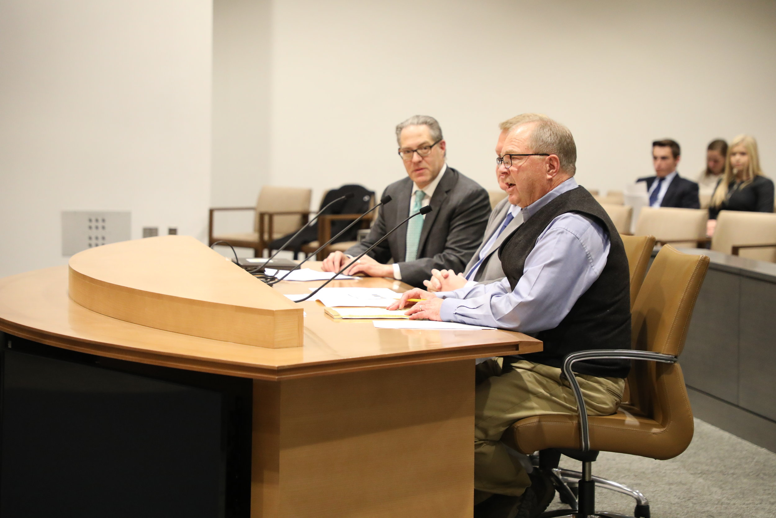 Lowell Pratt, Pratt Homes, and David Siegel, Housing First Minnesota Executive Director join Senator Rich Draheim in discussing SF3430 with the Senate Jobs Committee on Wednesday.