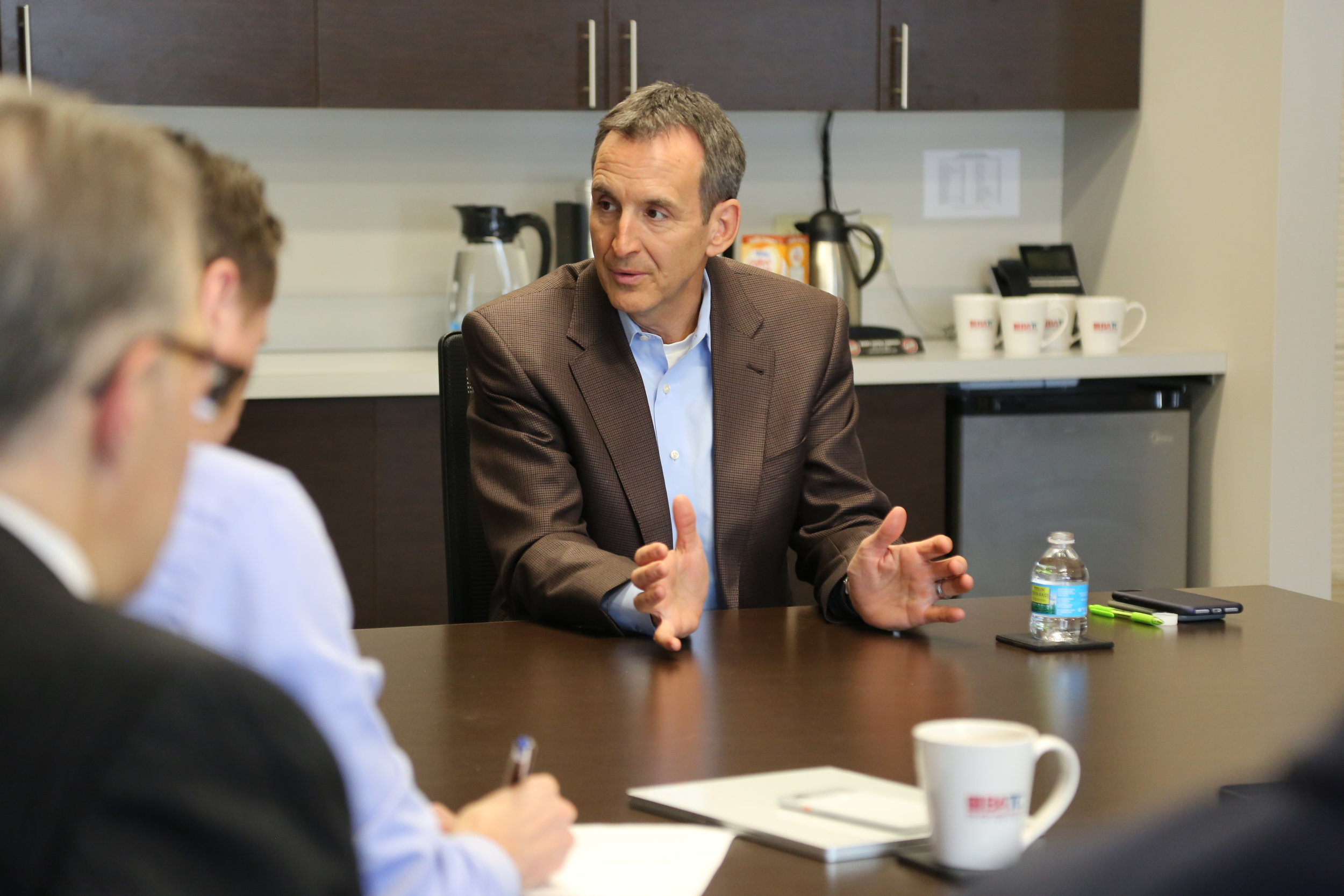 Former Governor Tim Pawlenty (R, Eagan), 2018 Gubernatorial Candidate, discusses housing issues with Housing First Minnesota leaders.