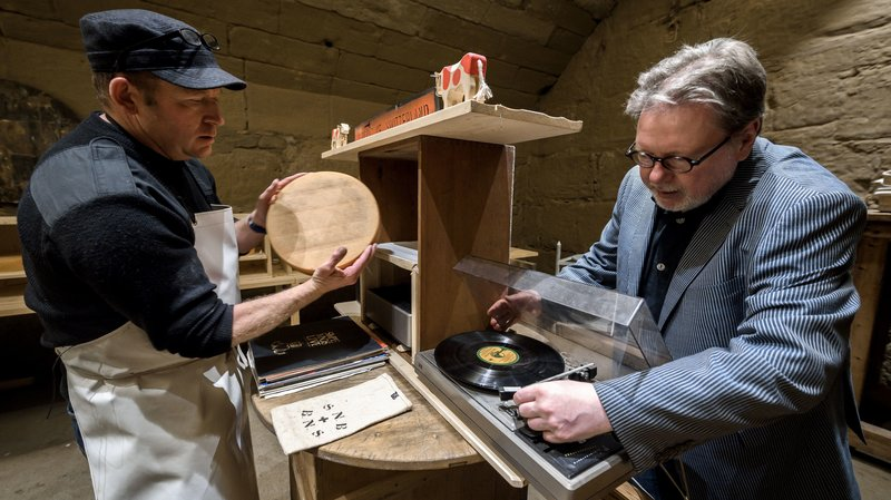 Swiss cheesemaker Beat Wampfler (left) and Michael Harenberg, director of the music department at the Bern University of the Arts, pose with a vinyl record and a wheel of Emmental.   Fabrice Coffrini/AFP/Getty Images