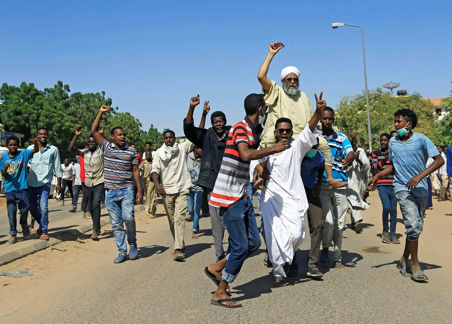 Sudanese protesters turn out near the home of a demonstrator who died of gunshot wounds. (Mohamed Nureldin Abdallah/Reuters)  Source