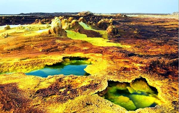Dallol   Resting in the northeastern region of Ethiopia lies the volcanic formation Dallol. It remains uninhabitable due to its dangerous fumes and its scorching environment and averages the highest temperatures anywhere on earth. Still, Dallol attracts many due to its martian-like landscape and for its abundance of mineral deposits, as it supplies 100% of Ethiopian salt.