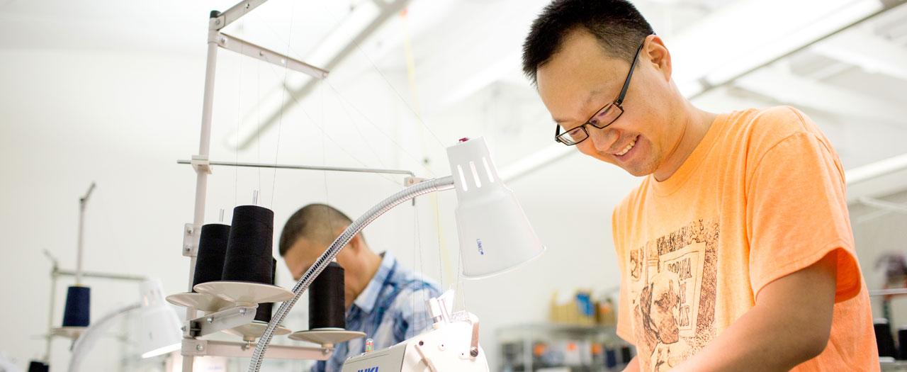 Kitsbow-Man-Orange-Shirt-Sewing-Machine-1280-525.jpg