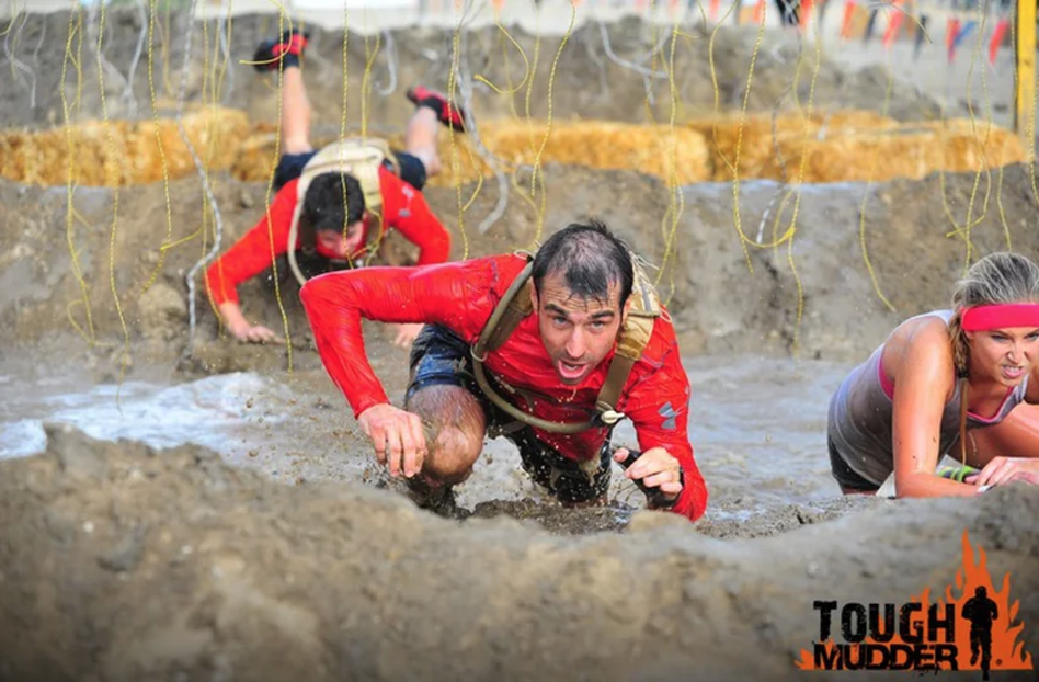 Chief Petty Officer Craig 'Morbs' Morby-Jones, Royal Navy, foreground, and Aircraft Engineering Technician John 'JD' Denny, rear, tackle the 'Electroshock therapy' obstacle.