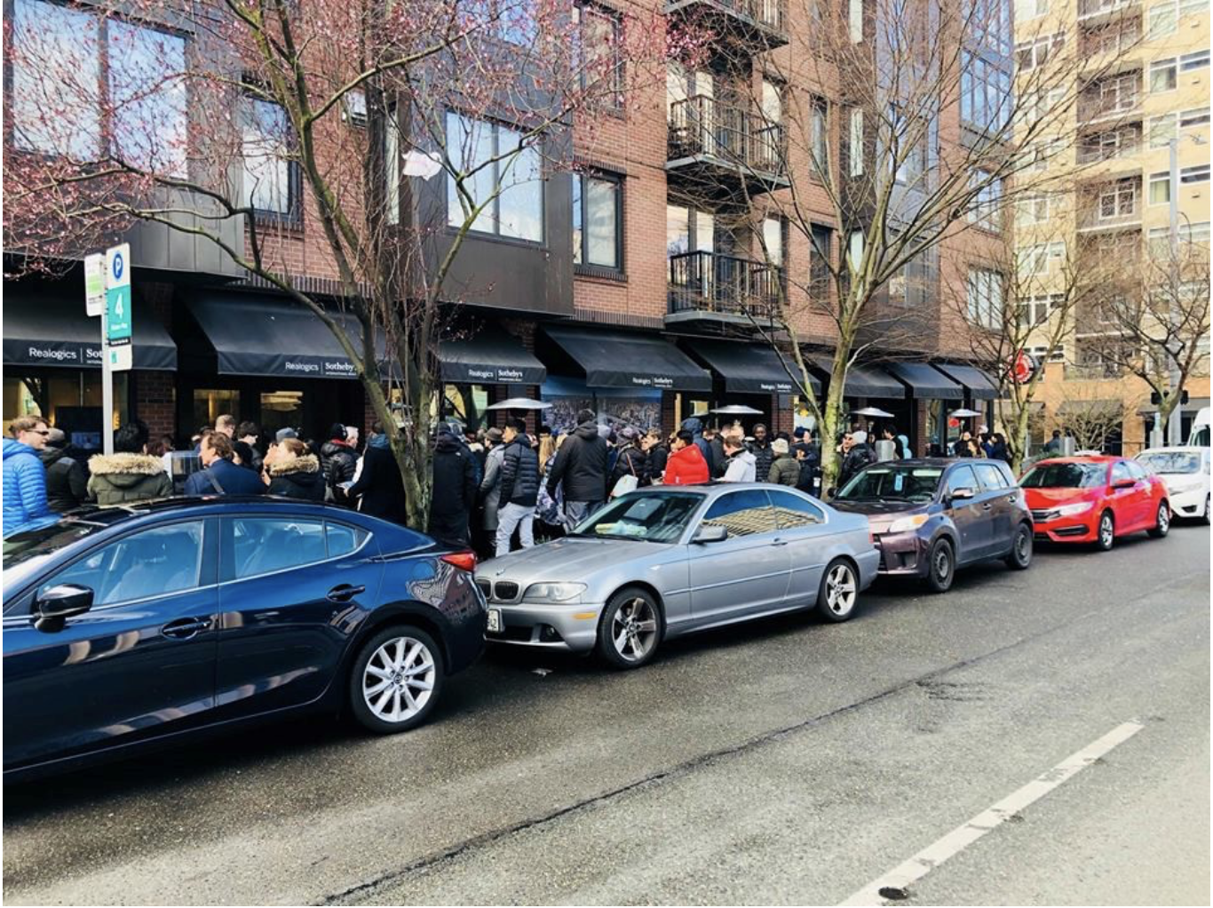PICTURED ABOVE: The KODA Condominium development generated a line of prospective buyers that eagerly awaited the release of 203 homes for reservation on February 24th, 2018.
