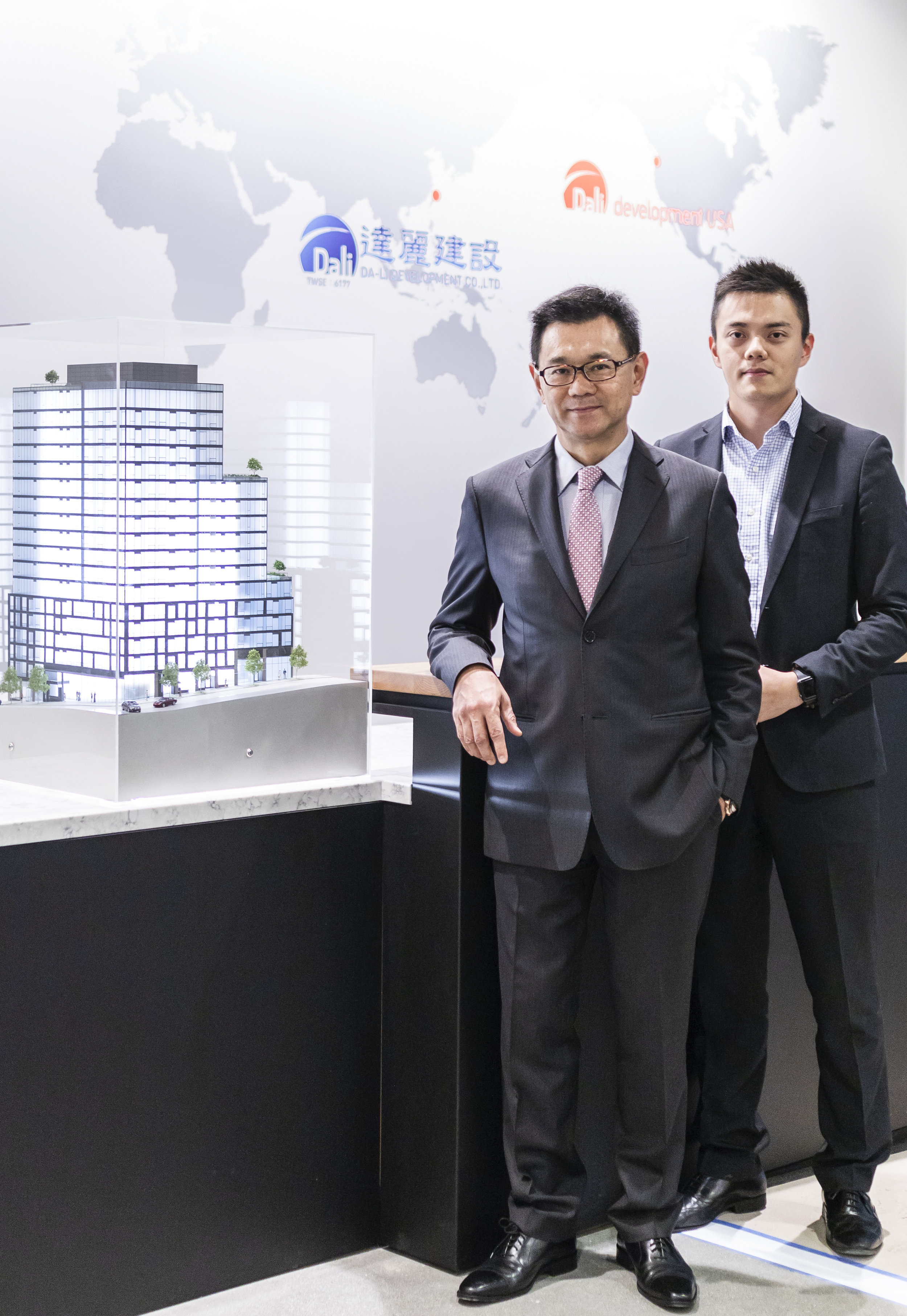 Da-Li Development USA Chairman James Hsieh, left, and his son and company Vice President Kevin Hsieh have opened a regional development office in Seattle's Pioneer Square. They're standing next to a model of Koda, a 17-story condominium project. Da-Li plans to break ground on the project this winter as it begins planning a second tower near the Space Needle.  REALOGICS SOTHEBY'S INTERNATIONAL REALTY