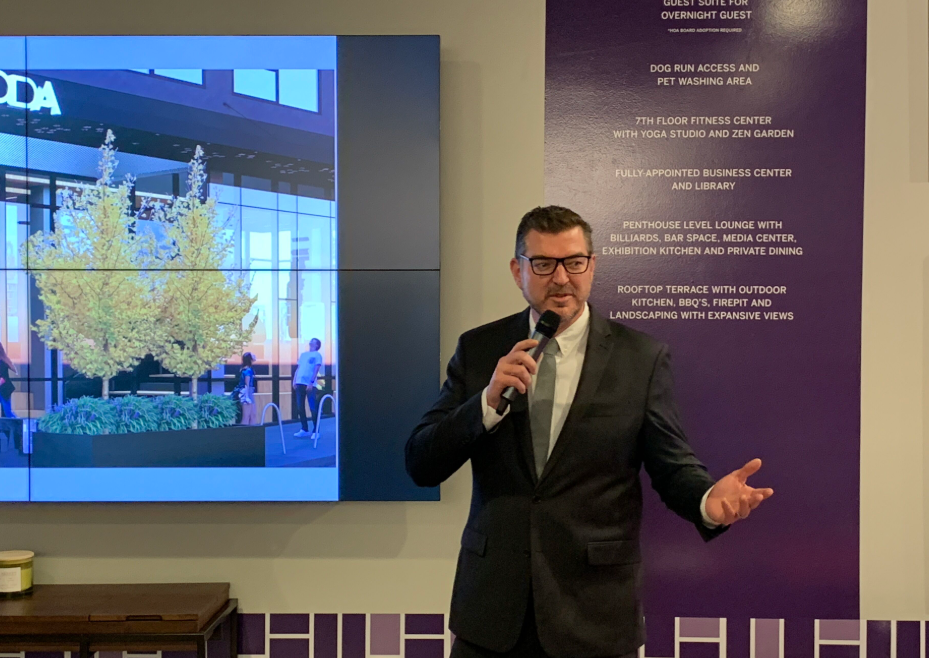 PICTURED ABOVE:    Da Li Development USA, LLC Executive Vice President Tom Doig, welcomes guests as the Master of Ceremonies during the Project Commencement Celebration.