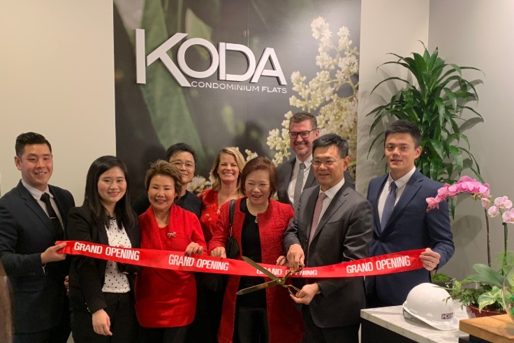 PICTURED ABOVE AND BELOW:    Members of Da Li Development (above) and Realogics Sotheby's International Realty (below) take turns with the ceremonial ribbon cutting of the new KODA Sales Gallery.
