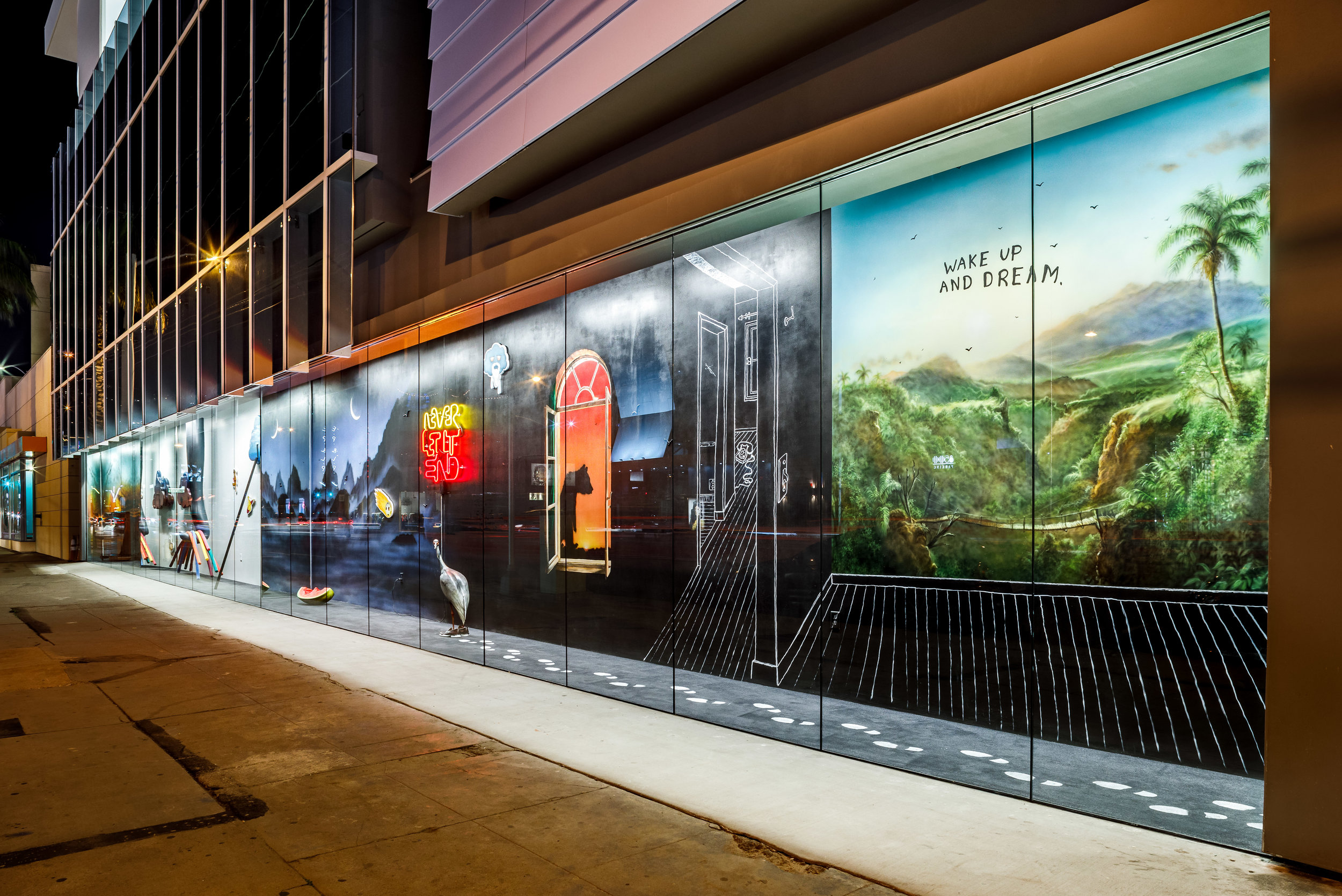 "Friedrich Kunath's art installation,  ""Wake up and Dream "" faces onto the sidewalk along La Cienega Boulevard at the ground floor of the new La Cienega wing of the CEE campus redevelopment project."