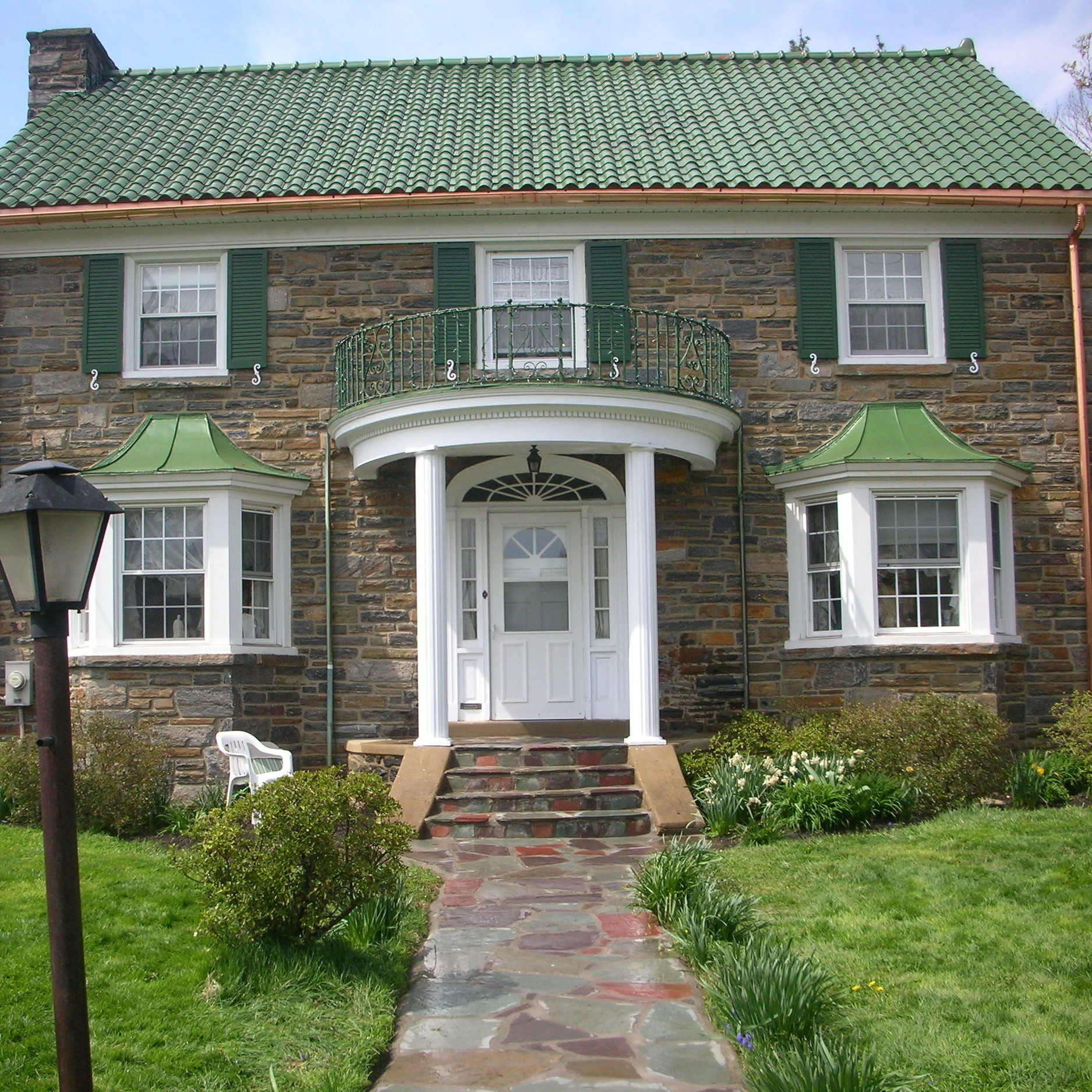 Sometimes, when the weather is nice, we can multitask for less than what it would cost to do each project individually. In this case, in Drexel Hill, we replaced any missing or damaged glazed Ludowici tile, installed a copper gutter system, stuccoed the rear garage, and rebuilt the entrance walkway.