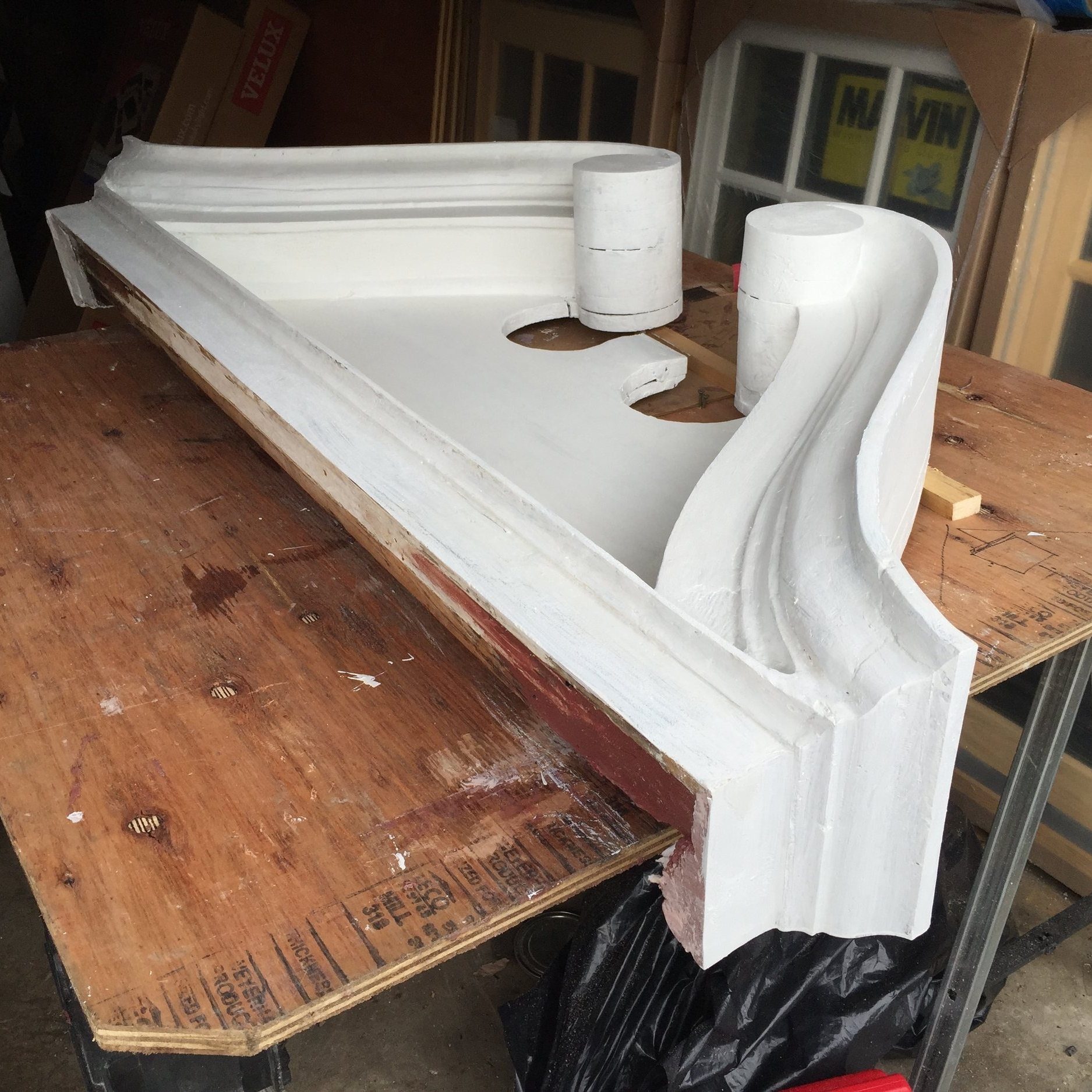 Believe it or not, this historic midcentury pediment was once completely rotted through, after its tin capping had become pitted over time. However, instead of replacing it in kind, we used a proprietary wood conservation epoxy / consolidant to strengthen the remaining wood grains and fill in the numerous voids.