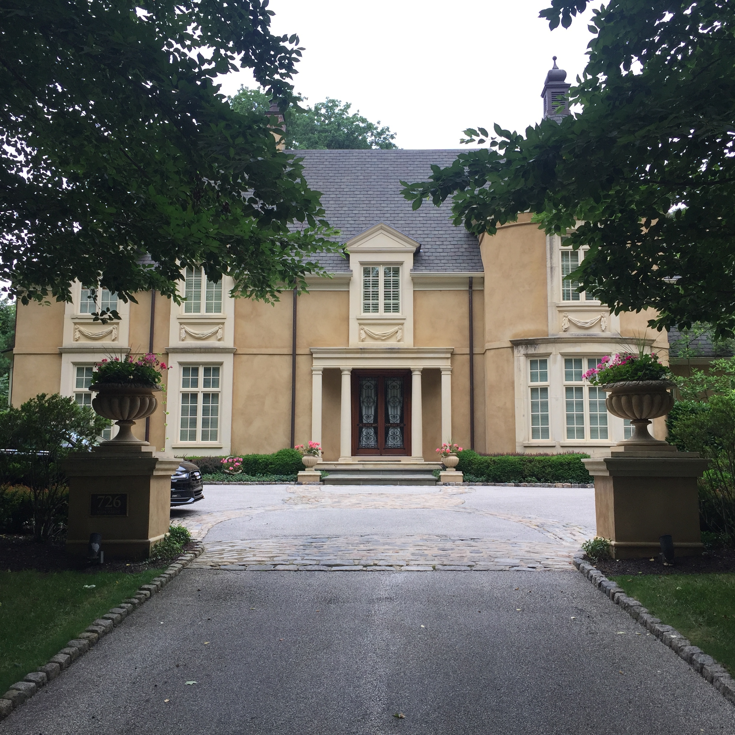 The gutters obscured by the canopy trees here were so high that the owners of this Bryn Mawr Estate couldn't find anybody to clean them. It took us some time, since the downspouts were all packed to the brim, but we got the dirty job done (and continue to do so, four times a year).