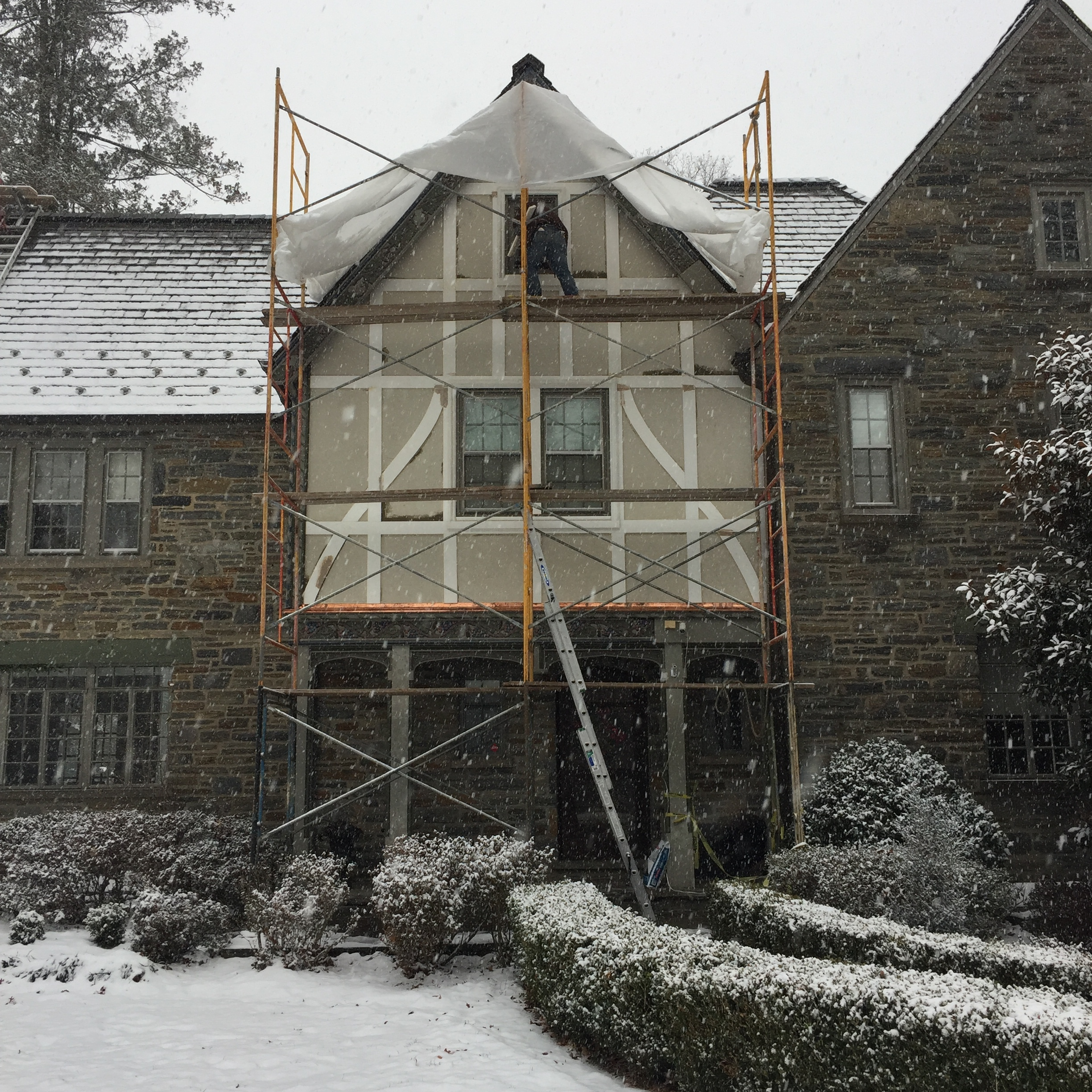 A blizzard passed by just as we were taking the scaffolding down for the winter. This is a partially completed project in which we have already replaced all the vertical timbers, which had rotted out, as well as re-flashed any adjoining metalwork, now in copper; and are currently hand carving irrevocably lost sections of ornamental woodwork, located at the top and bottom of the stucco façade. This spring we will both re-stucco the cracked façade and install the replicated woodcarvings.