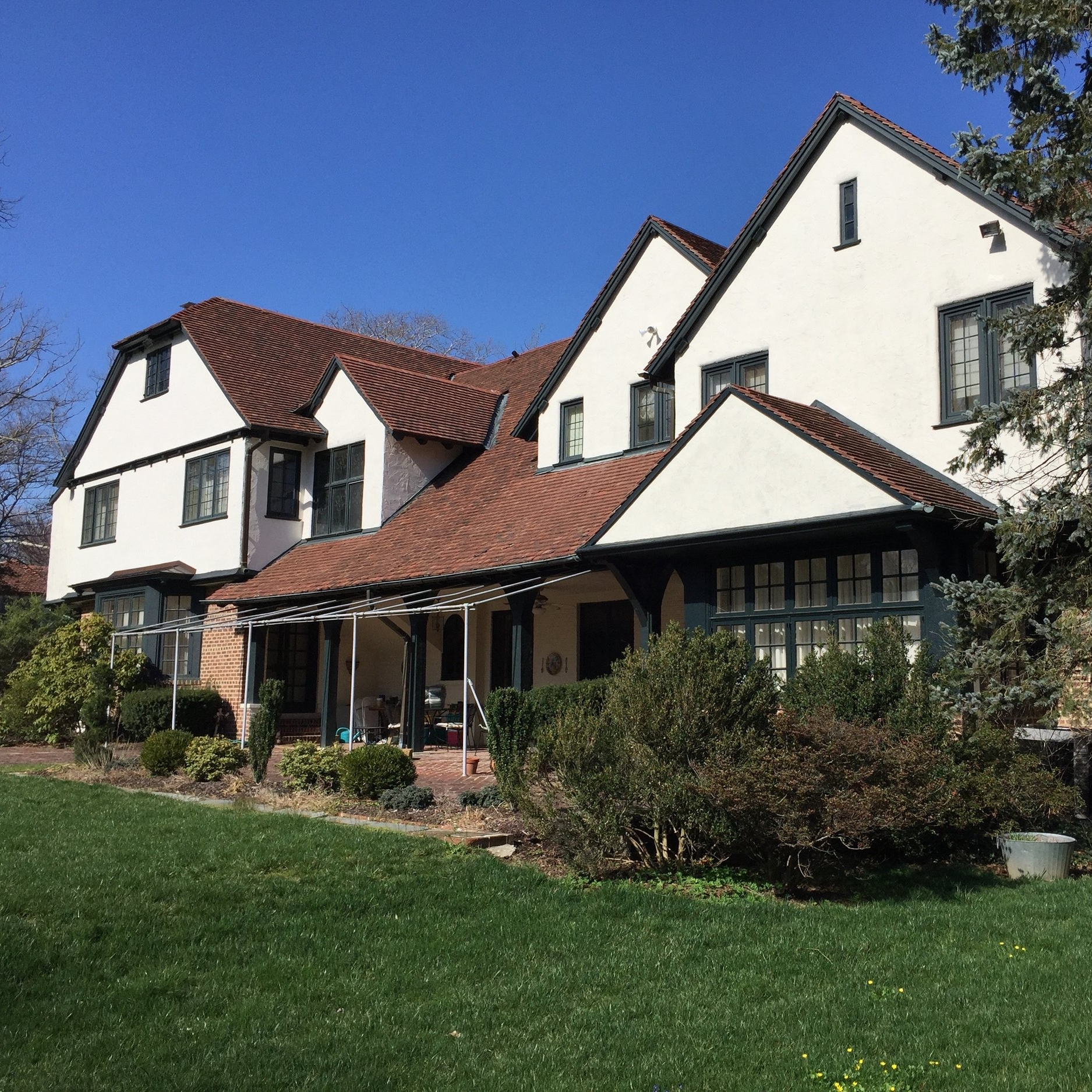 """Rehabilitated this historic terracotta roof designed by Wilson Eyre – a renowned Philadelphia architect, who, on this former country house, in Rosemont, had roughened the vertical enclosure by flipping the flat, """"fire-skinned"""" tiles over onto their grooved, mold-pressed sides."""