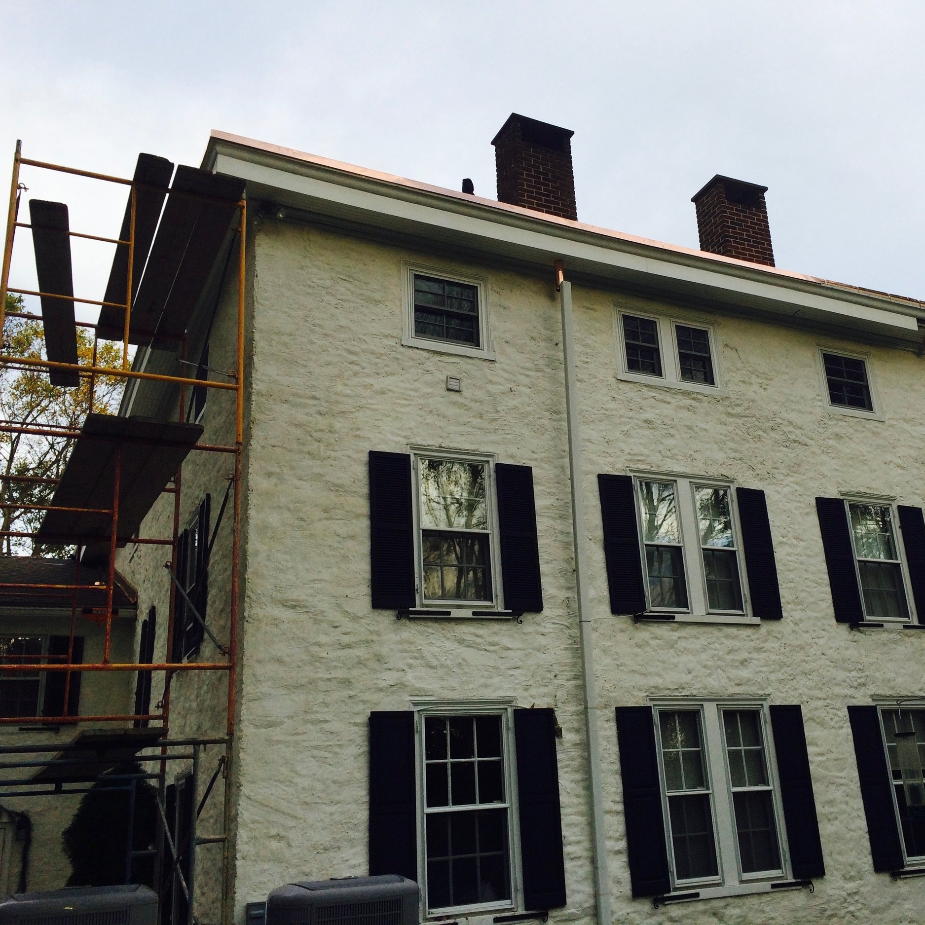 This historic farmhouse, in Dilworthtown, had major problems with its flat roof, pole gutters, drainage system, soffit, and fascia – all of which we had to rebuild, mostly in copper. The owners found us after searching for traditional roofers comfortable enough to solder over 200' of copper pole gutters, as everybody else had wanted to instead cover it all with wood decking and external aluminum gutters. This spring, we will continue such renovations by restoring the widow's walk that once provided a panoramic view of the surrounding farmland.