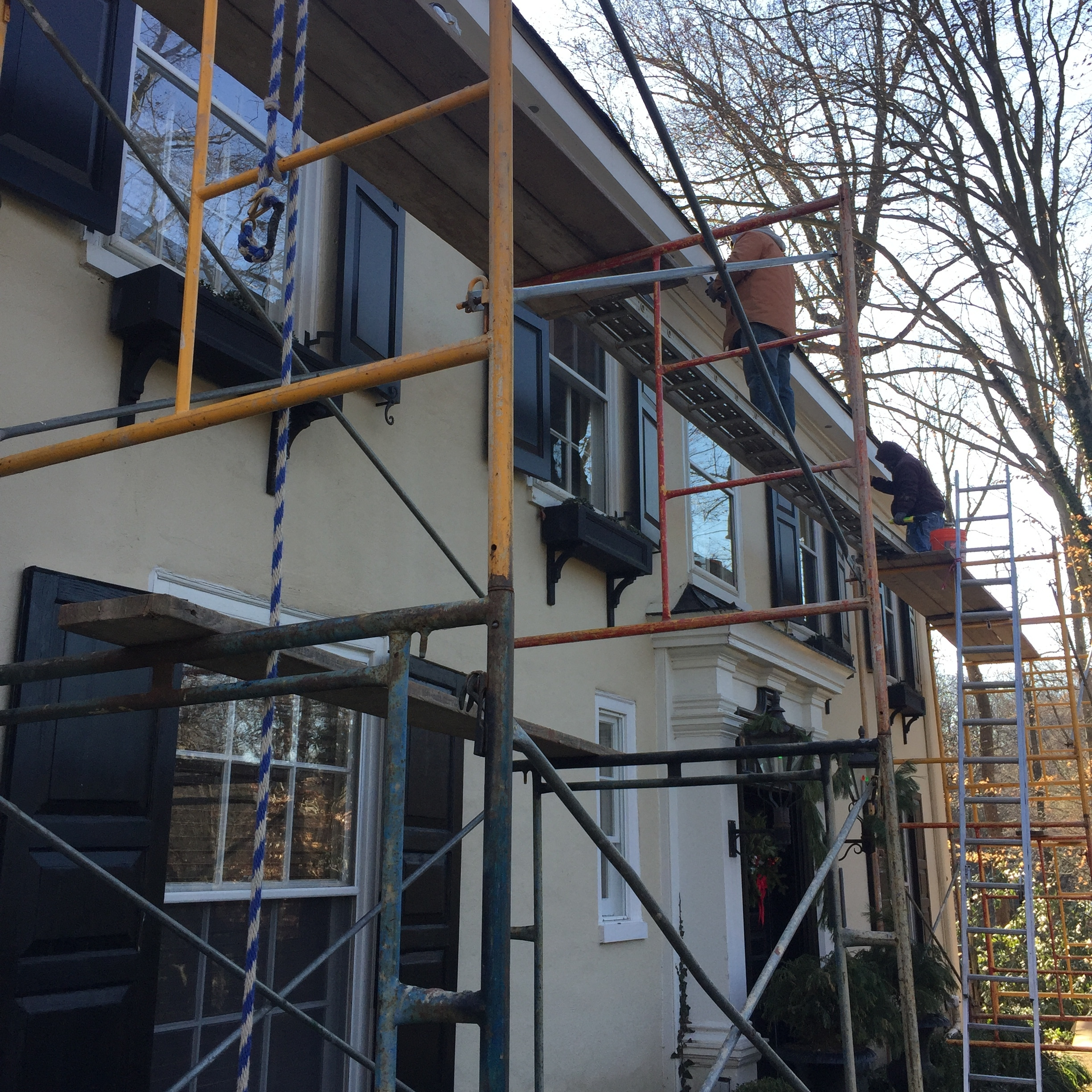 Project site photos of the scaffolding we erected to rebuild the rotted fascia and soffits of this historic Haverford farmhouse. It was 0 °F that day (probably less with the gusts of residual high-pressure arctic air that had followed the early 2018 bombogenesis).
