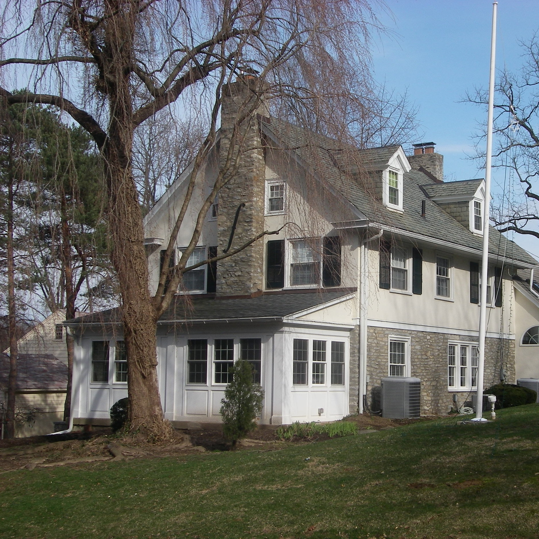 """We rebuilt the pitted / mucked aluminum dormer valleys with copper flashing, reglet cut copper flashing into the chimneys, and installed a 6"""" seamless gutter system, on this country club-style residence, in Springfield."""