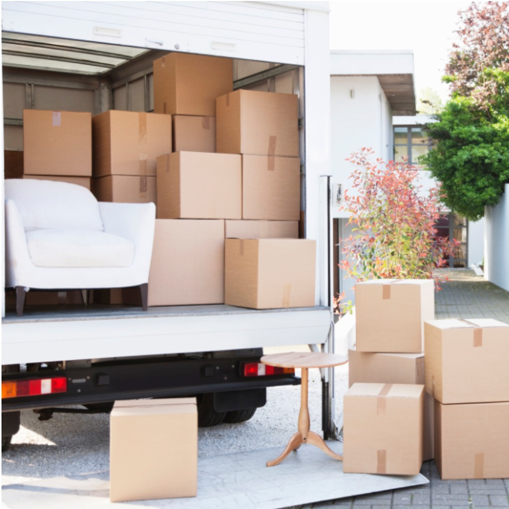 boxes-on-ground-near-moving-van-picture-id135385164 (1).jpg