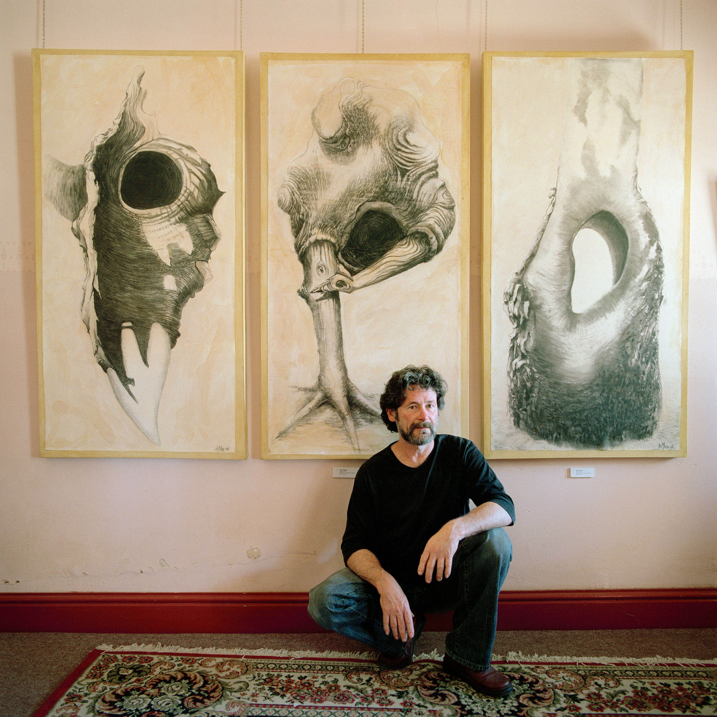 Artist Geoff DeMain at his gallery in Broken Hill, NSW, 2008. The artist's drawings reflect the Government's enabling of the continuing destruction of the Darling River through the allegory of the 'Three Monkeys.'