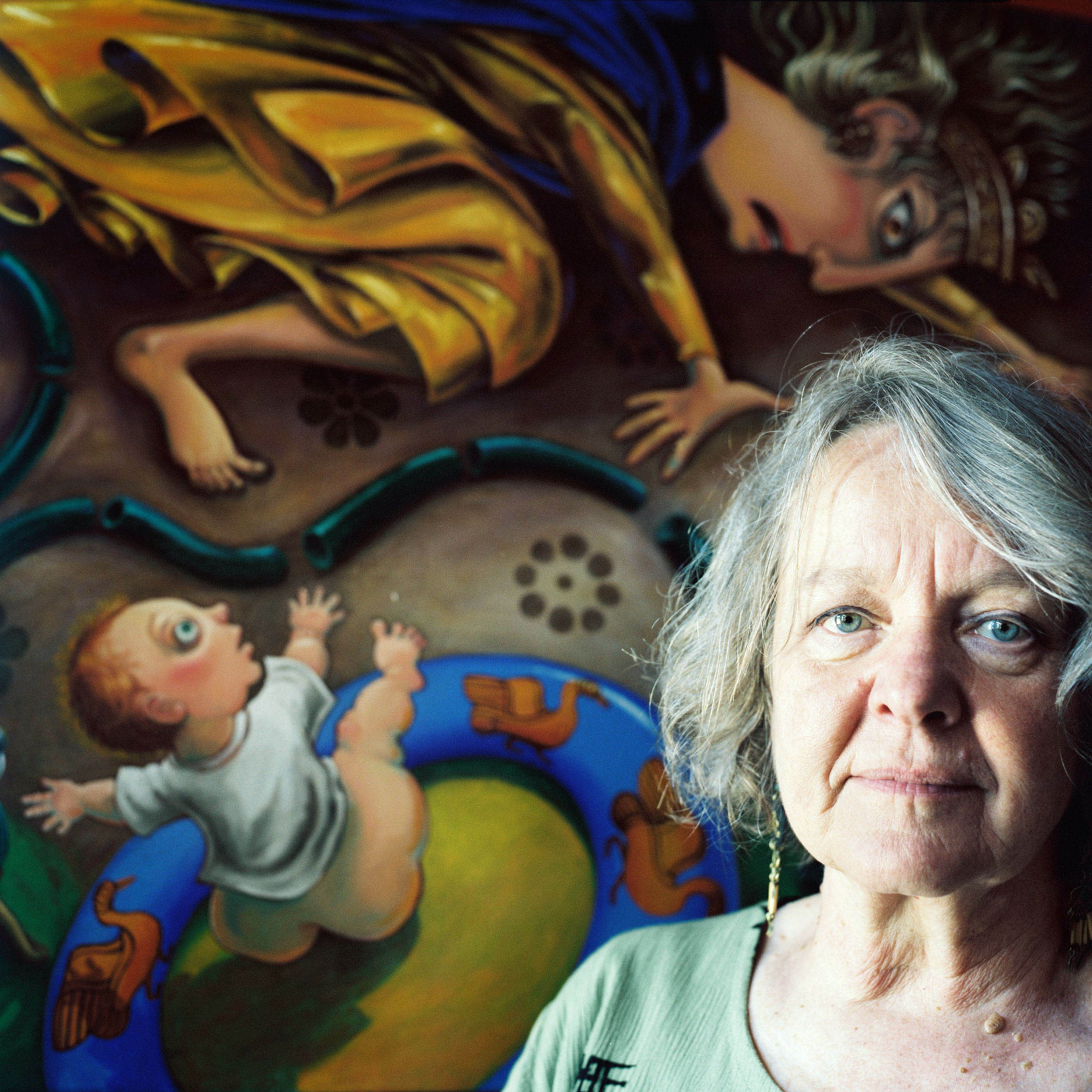 "Janet Goodchild-Cuffley, with her painting ""Demeter Introduces Stage IV Water Restrictions,"" Malmsbury, VIC, 2008. In this artwork, Janet draws paralells between Australia's cycle of drought and Demeter's act of witholding growth and fertility of the earth."