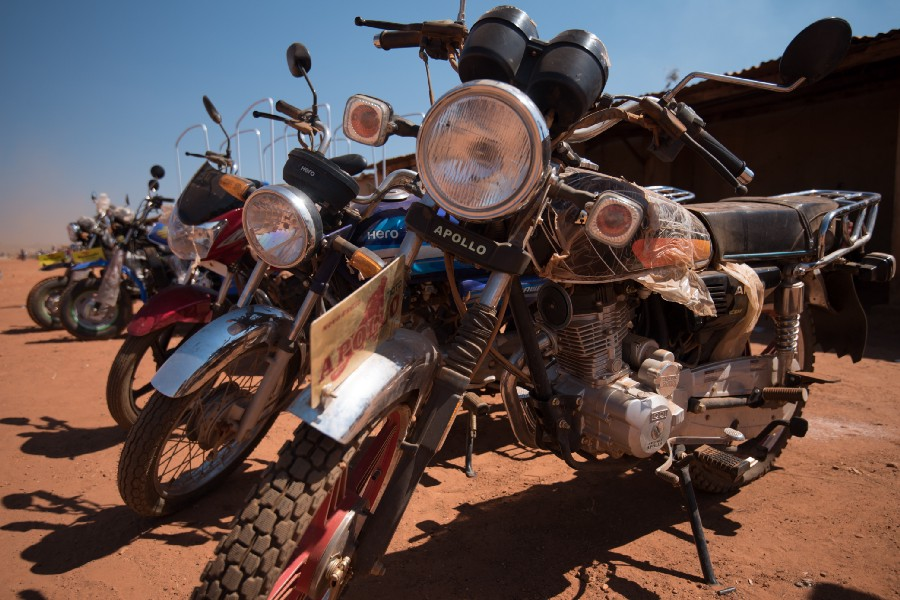 Motorcycles are fast becoming the preferred mode of travel to access areas and transport goods between markets. Photo: Chris Boyes