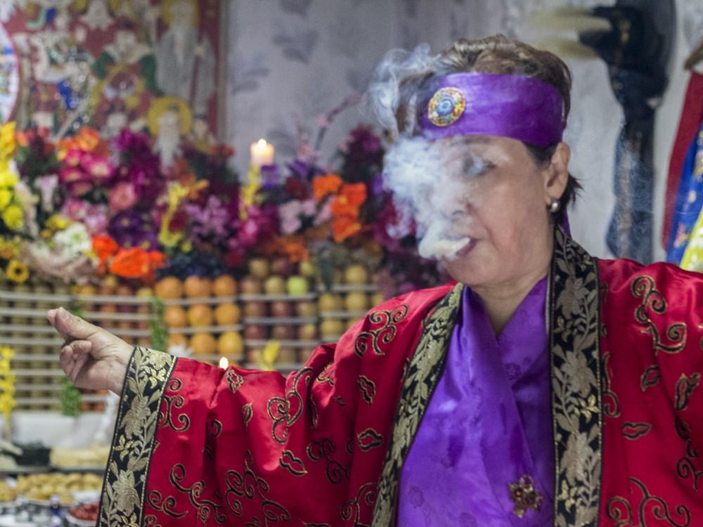 A Chinese Envoy of Death God appears at a shamanic ritual in a dedicated ritual space called a gutdang, near Kookmin University, Seoul. This particular female god enjoys heavy drinking and smoking, demanding to be pleased in order to placate her anger. The ritual was carried out by manshin Kim Nam-Sum.