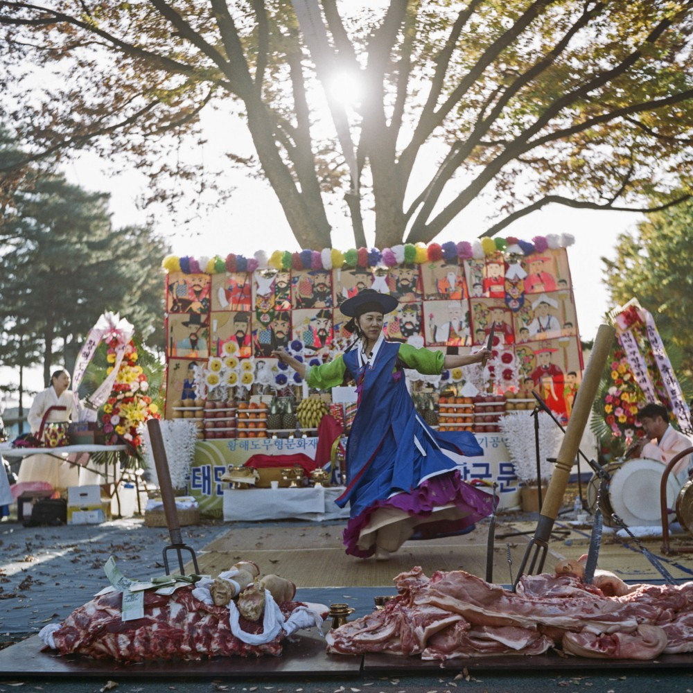 Manshin Min Hye-Gyeong carries out a public ritual at Namhansanseong Mountain near Seoul. She represents a younger generation of shamans who make good use of  social media  and other digital platforms.