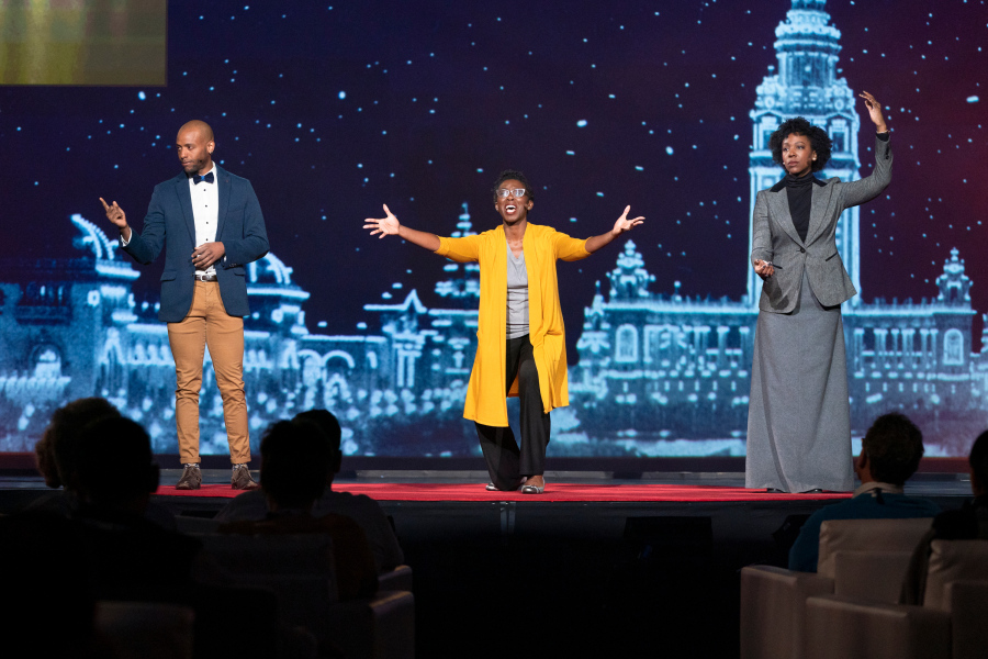 Amma Ghartey-Tagoe Kootin (center) with performers from her new musical,  At Buffalo, a s the groundbreaking TED Fellows program celebrates its 10th anniversary. Fellows Session 1 at TED2019: Bigger Than Us, April 15, 2019, Vancouver, BC, Canada. (Photo: Ryan Lash / TED)
