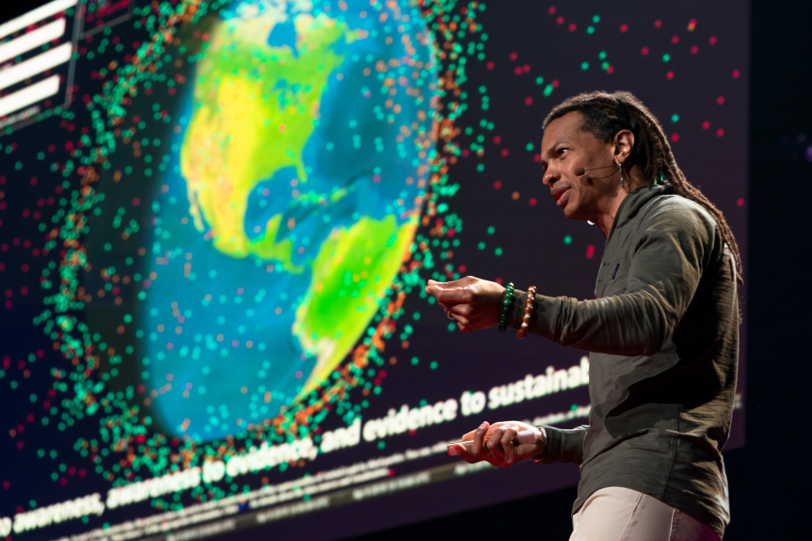 Moriba Jah shares a visualization of space junk during TED Fellows Session 2 at TED2019: Bigger Than Us, on April 15, 2019 in Vancouver, BC, Canada. (Photo: Ryan Lash / TED)