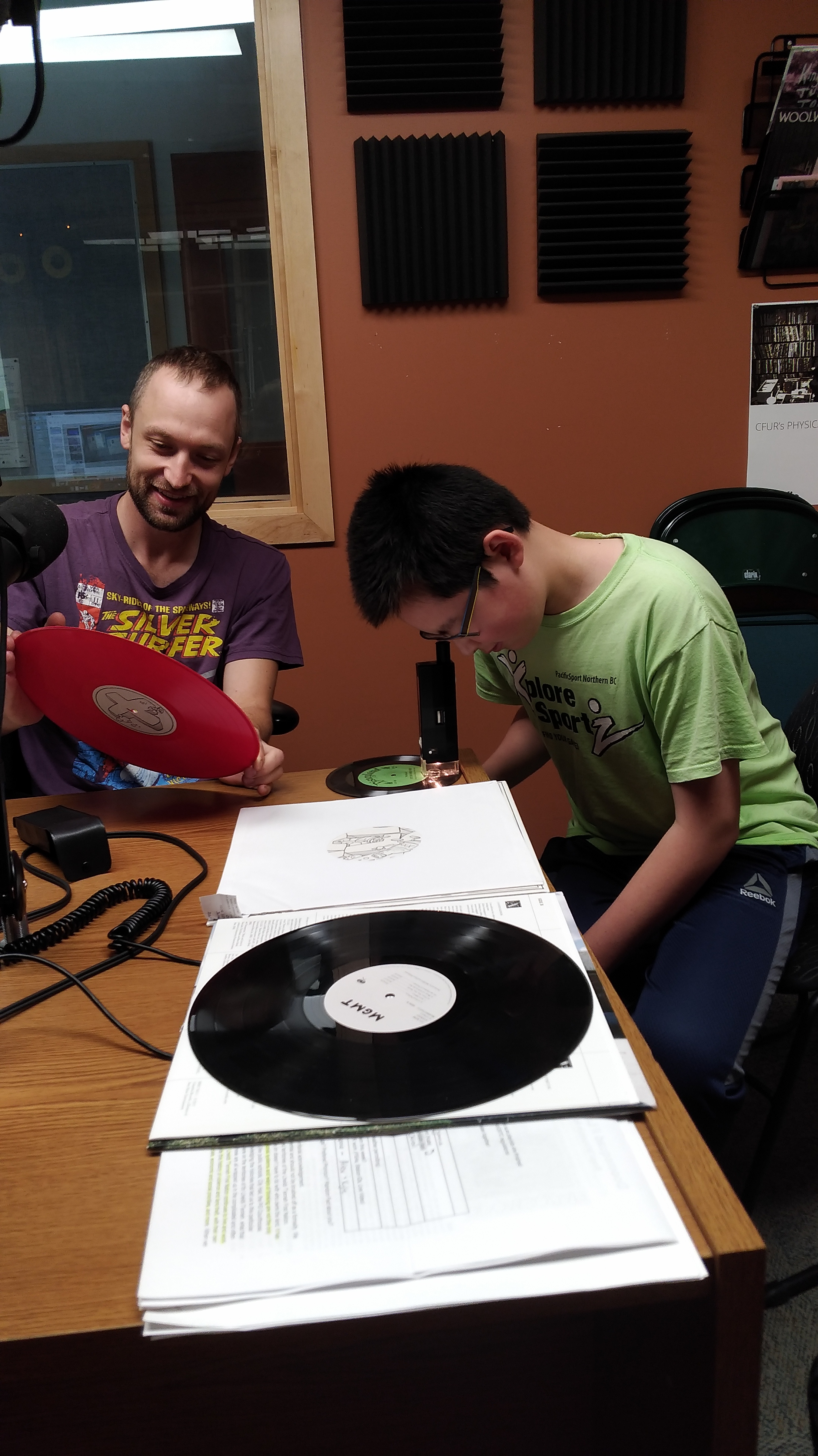 Our Station Manager and a Radio Camper exploring the sound waves carved in to vinyl records.