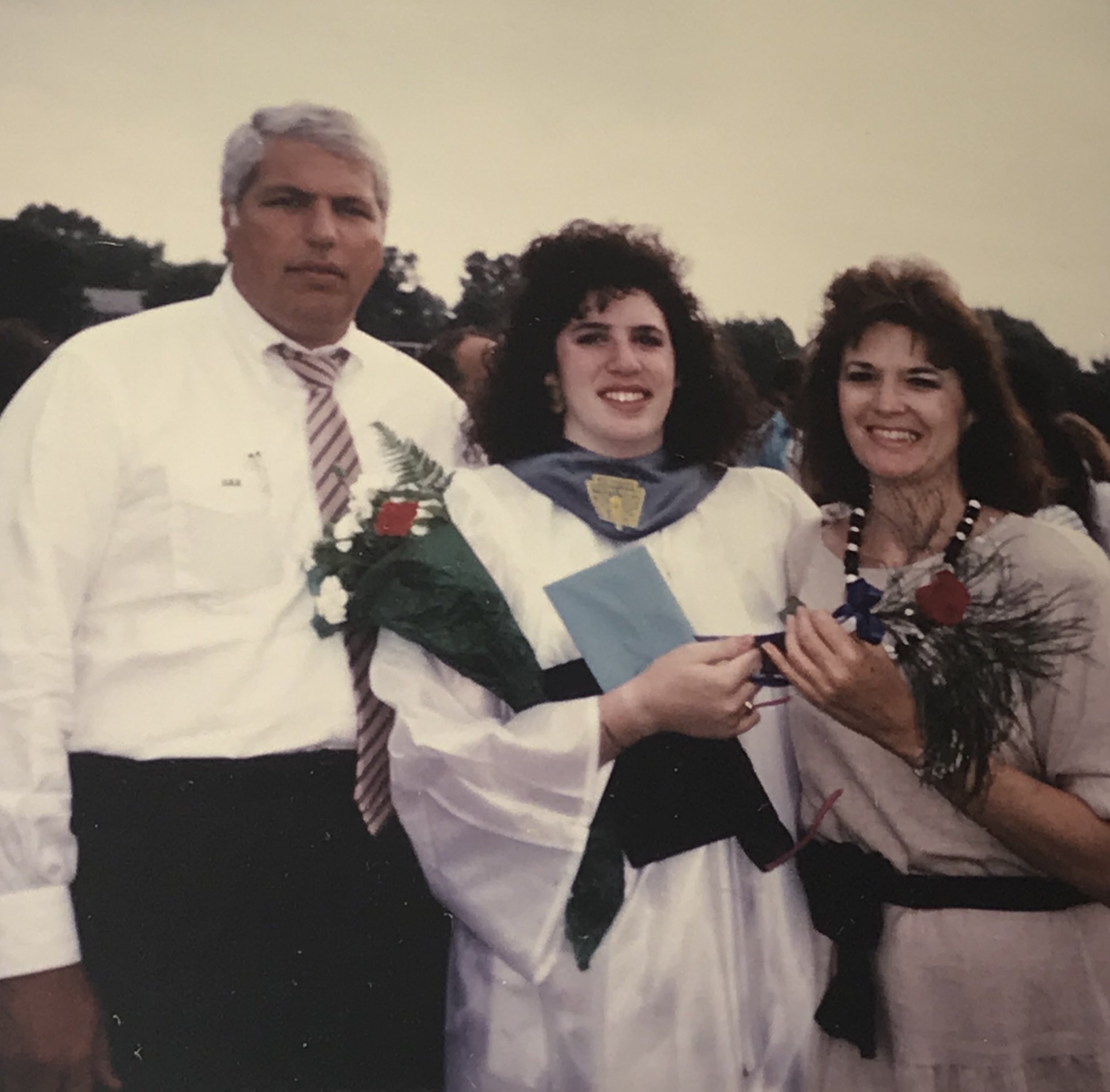 Posing with my parents and my cool shades at my high school graduation