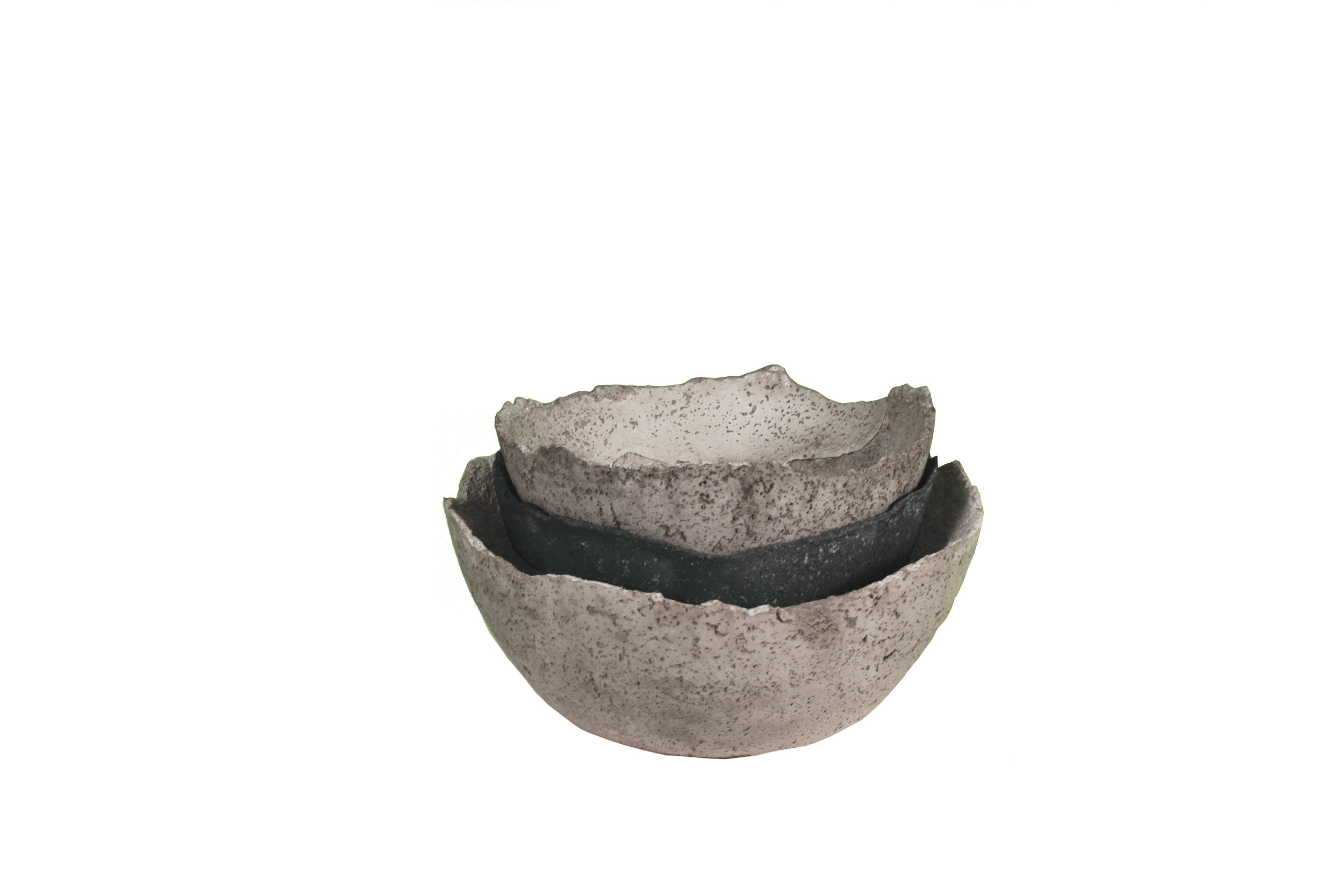 Stack of blue and grey concrete bowls - wabi-sabi