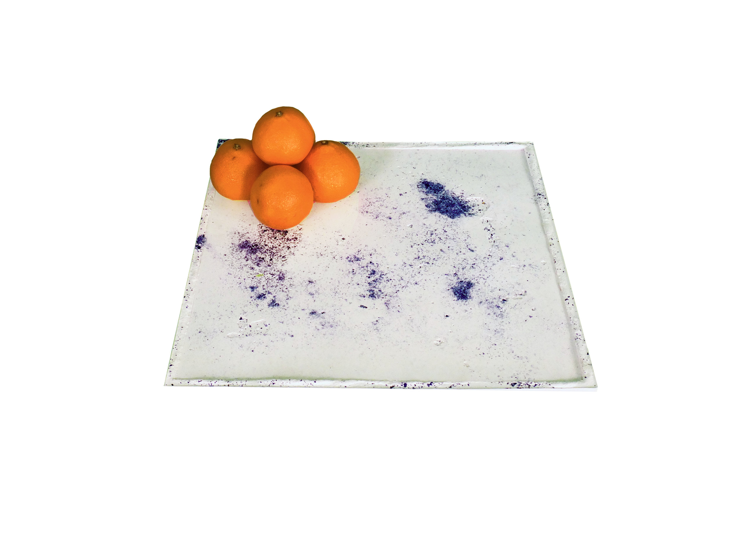 Blue concrete tray with oranges