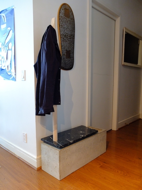 Bespoke concrete bench with integrated coat rack