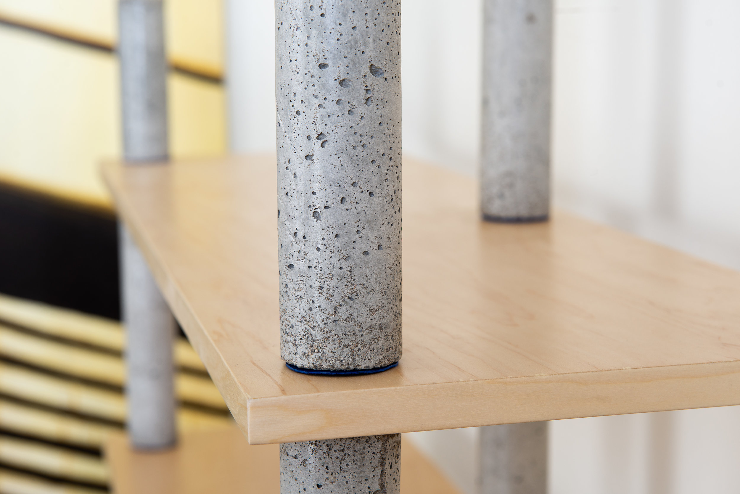 Concrete bookcase pillars