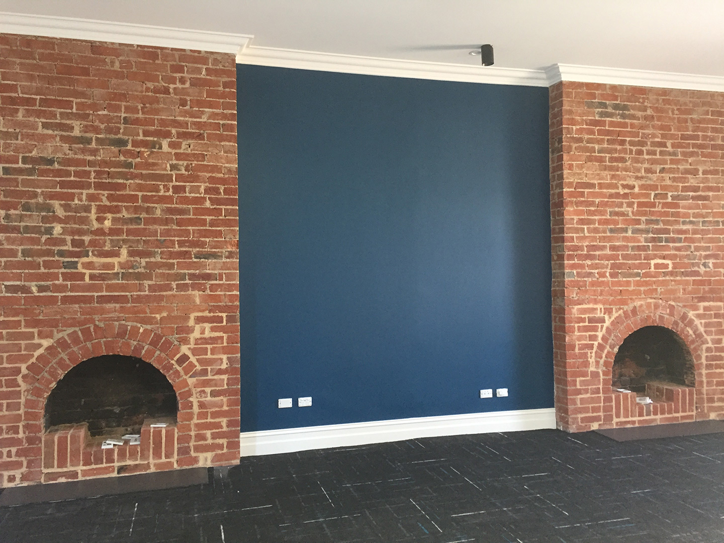 CAMMS_blue-wall-fire-place.jpg