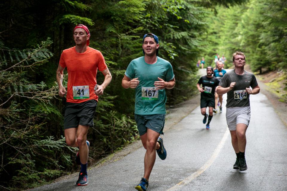 Runners wearing the designed race bibs.
