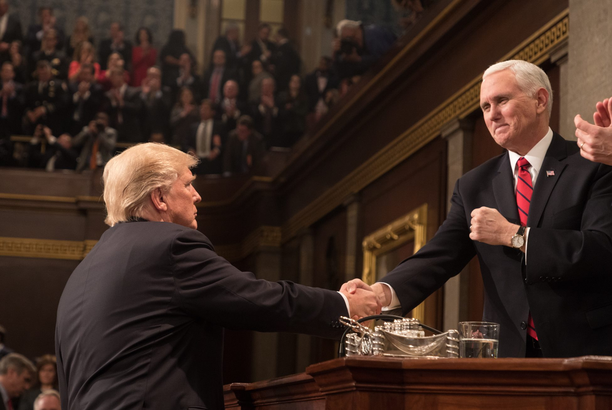 Pence (RIGHT) shakes hands with President Donald Trump  Photo by Vice President's Office