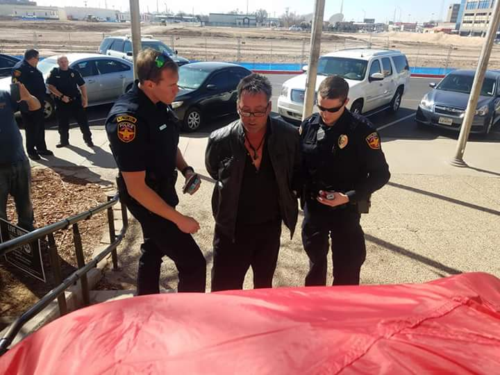 Billups being arrested during a protest at City Hall in March 2018  Photo by Susan Cooper Bailey