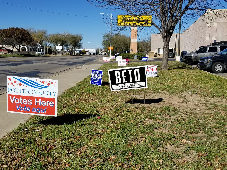 Yard signs in front of Buzula on November 6, 2018  Photo by Thomas Warren III