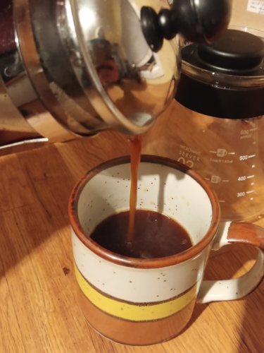A viscous cup of delicious pressed coffee.